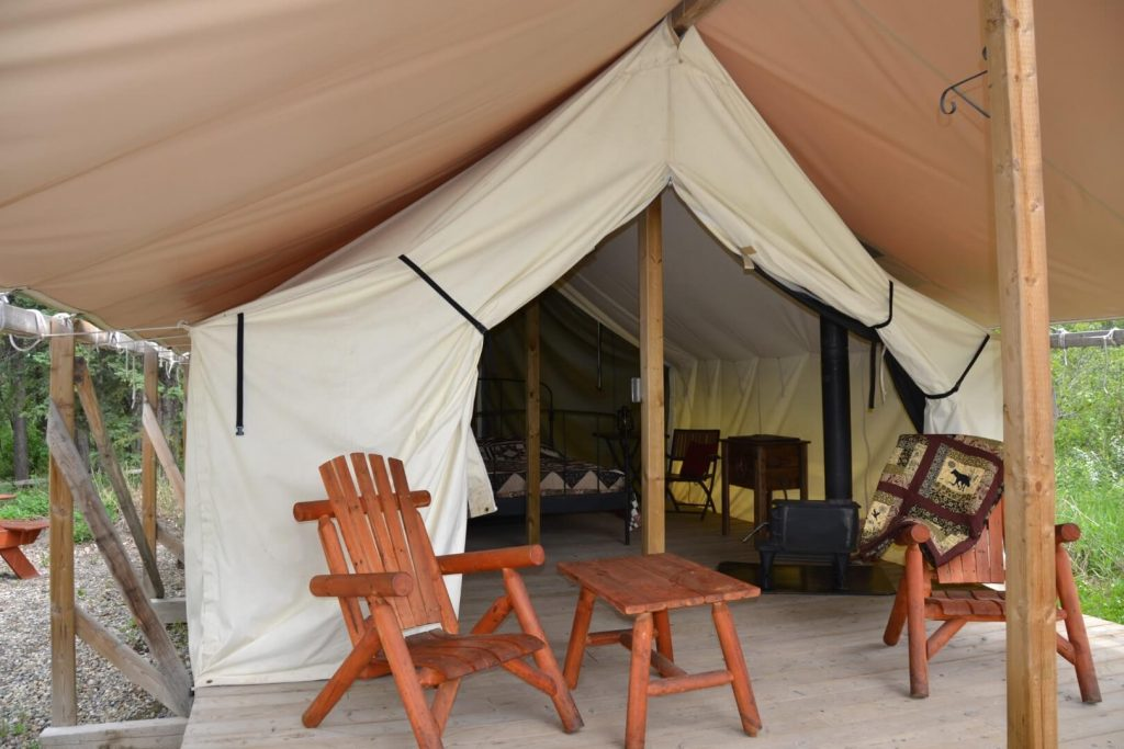 riverview campground outfitter tent with chairs and table